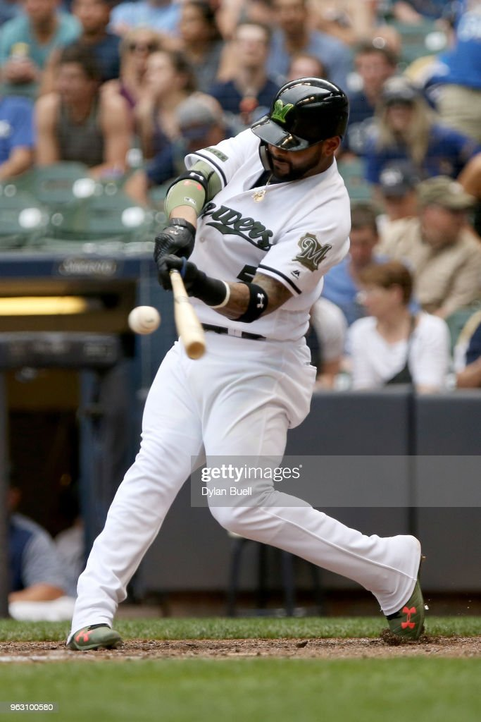 Jonathan Villar #5 of the Milwaukee Brewers hits a double in the seventh inning against the New York Mets at Miller Park on May 27, 2018 in Milwaukee, Wisconsin.