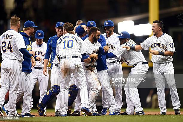 Jonathan Villar of the Milwaukee Brewers is congratulated by teammates after hitting the game winning RBI against the St Louis Cardinals during the...