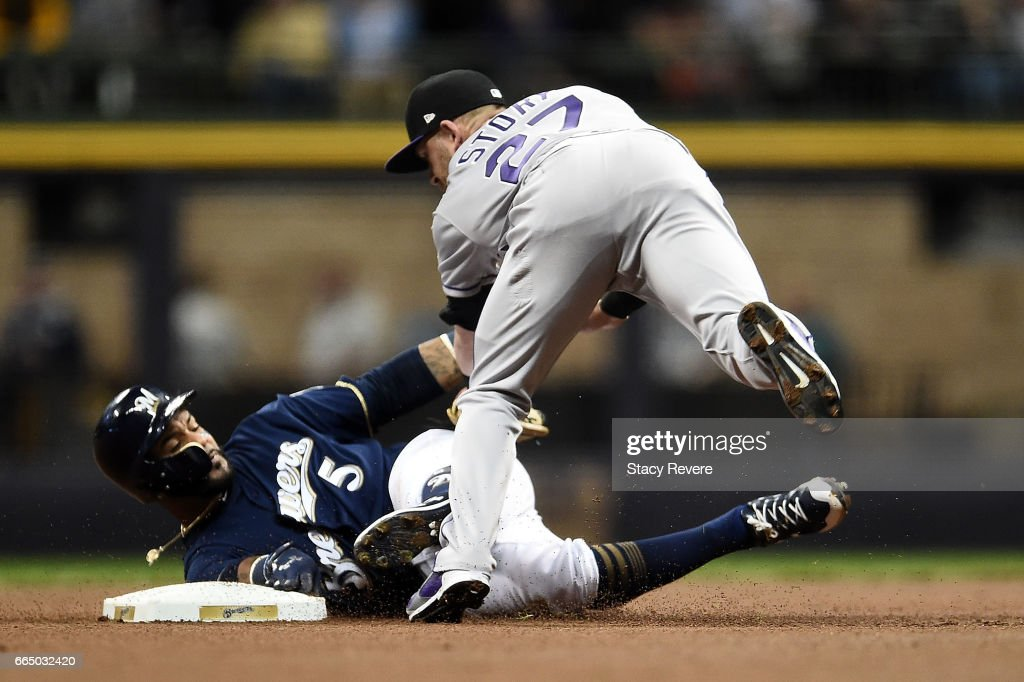 Jonathan Villar #5 of the Milwaukee Brewers is tagged out at second base by Trevor Story #27 of the Colorado Rockies during the first inning of a game at Miller Park on April 5, 2017 in Milwaukee, Wisconsin.
