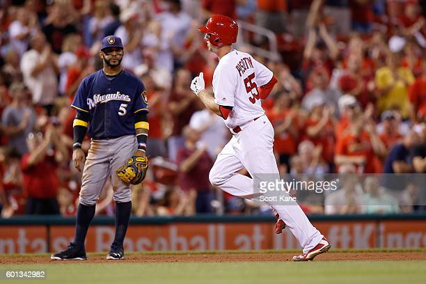 Jonathan Villar of the Milwaukee Brewers looks on as Stephen Piscotty of the St Louis Cardinals runs the bases after hitting a tworun home run during...