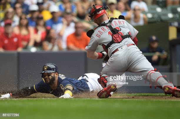 Jonathan Villar of the Milwaukee Brewers scores during the first inning against the Cincinnati Reds at Miller Park on August 13 2017 in Milwaukee...