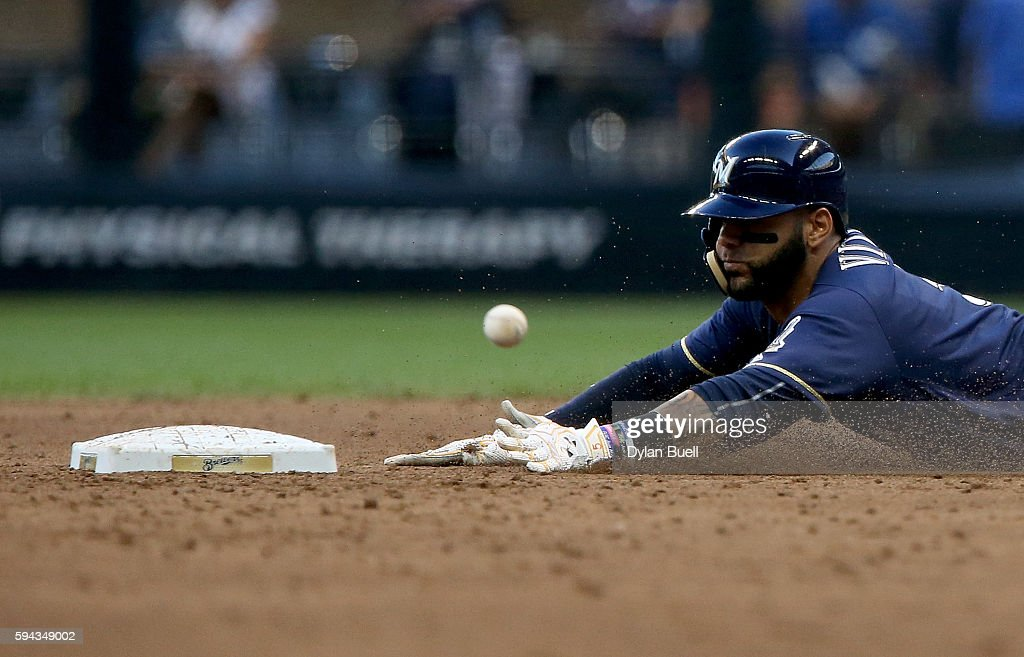 Jonathan Villar #5 of the Milwaukee Brewers steals second base in the second inning against the Colorado Rockies at Miller Park on August 22, 2016 in Milwaukee, Wisconsin.
