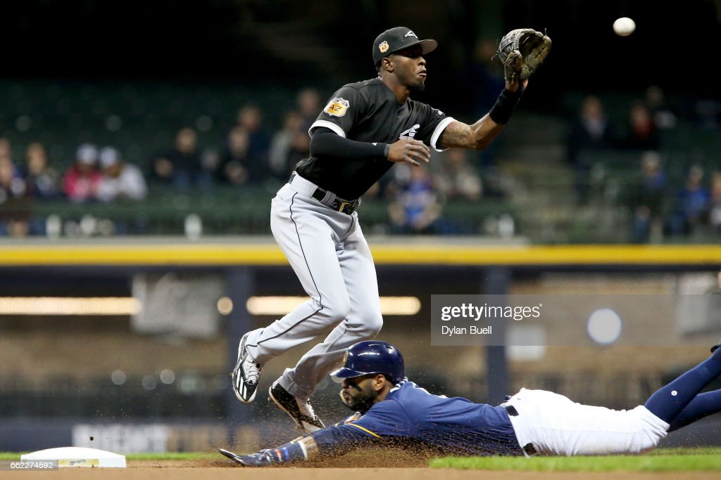 Jonathan Villar #5 of the Milwaukee Brewers steals second base past Tim Anderson #7 of the Chicago White Sox in the first inning during an exhibition game at Miller Park on March 31, 2017 in Milwaukee, Wisconsin.