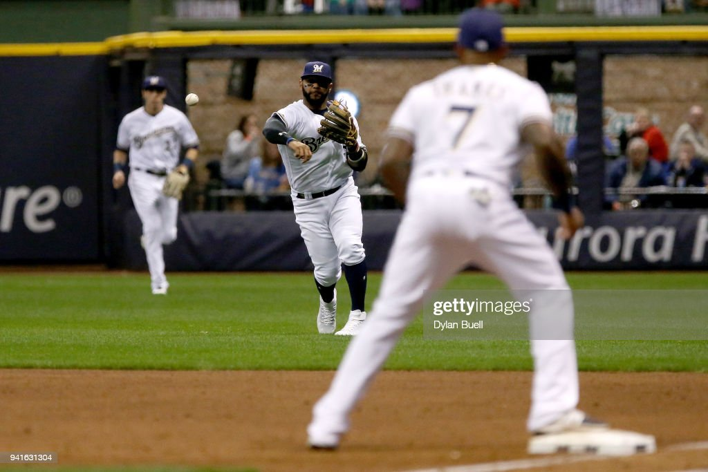 Jonathan Villar #5 of the Milwaukee Brewers throws to first base from right field in the fourth inning against the St. Louis Cardinals at Miller Park on April 3, 2018 in Milwaukee, Wisconsin.