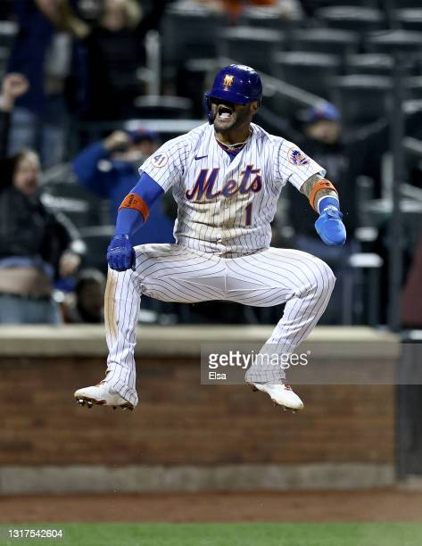 Jonathan Villar of the New York Mets celebrates after he scored the game winning run on a fielder's choice in the bottom of the ninth against the...