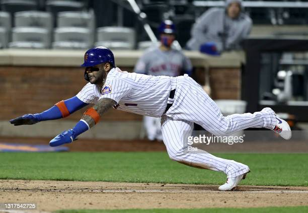 Jonathan Villar of the New York Mets scores the game winning run in the bottom of the ninth against the Baltimore Orioles at Citi Field on May 11,...