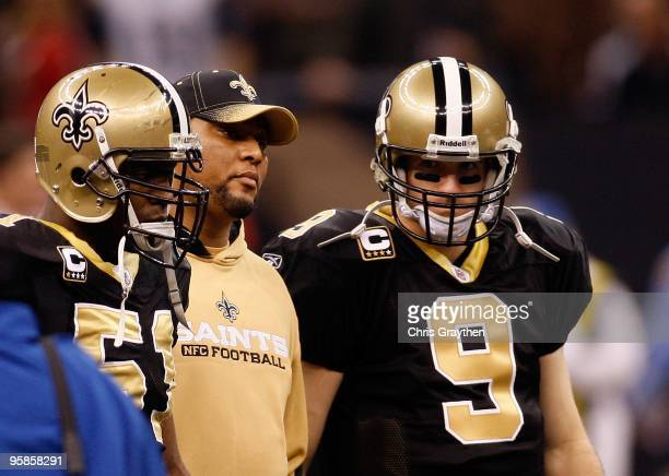 Jonathan Vilma Deuce McAllister and Drew Brees of the New Orleans Saints stand on the field for the captain's meeting against the Arizona Cardinals...