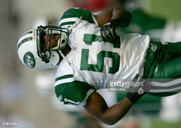 Jonathan Vilma of the New York Jets runs during the game against the Arizona Cardinals at Sun Devil Stadium on November 28 2004 in Tempe Arizona The...