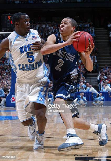 Jonathan Wallace of th Georgetown Hoyas drives the ball against Ty Lawson of the University of North Carolina Tar Heels in the NCAA Men's East...