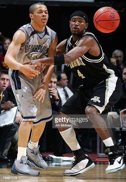 Jonathan Wallace of the Georgetown Hoyas passes the ball against Derrick Byars of the Vanderbilt Commodores during the NCAA Men's East Regional...