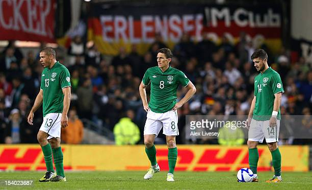 Jonathan Walters Keith Andrews and Shane Long of Republic of Ireland look on after conceding the sixth goal to Germany during the FIFA 2014 World Cup...