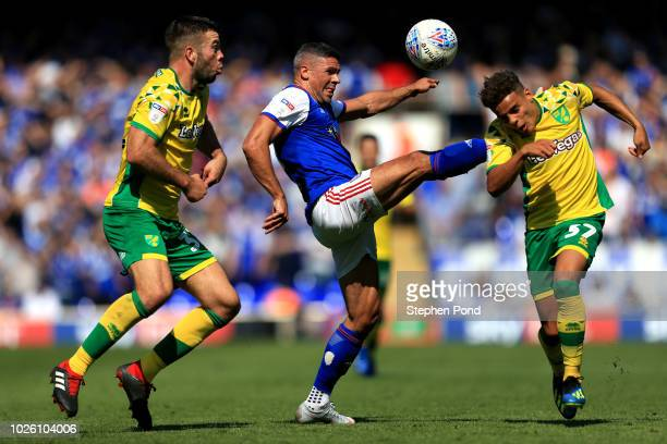 Jonathan Walters of Ipswich Town battles with Max Aarons and Grant Hanley of Norwich City during the Sky Bet Championship match between Ipswich Town...