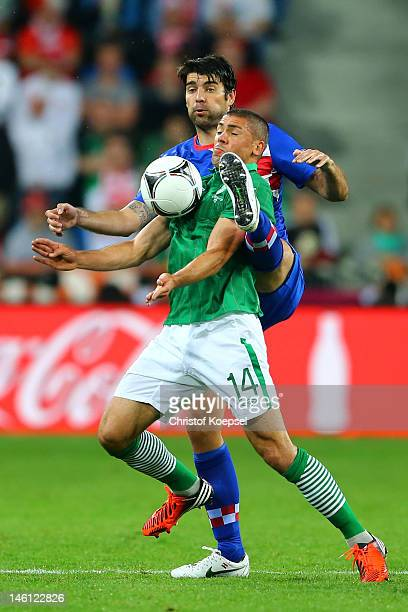 Jonathan Walters of Republic of Ireland and Vedran Corluka of Croatia compete for the ball during the UEFA EURO 2012 group C between Ireland and...