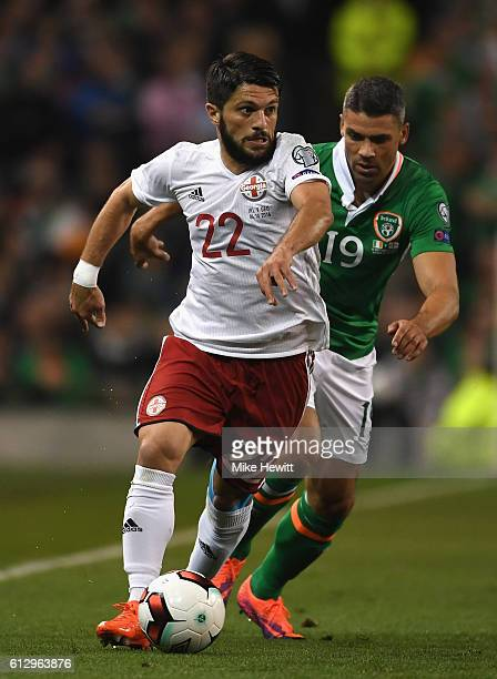 Jonathan Walters of Republic of Ireland closes down Giorgi Navalovski of Georgia during the FIFA 2018 World Cup Group D Qualifier between Republic of...