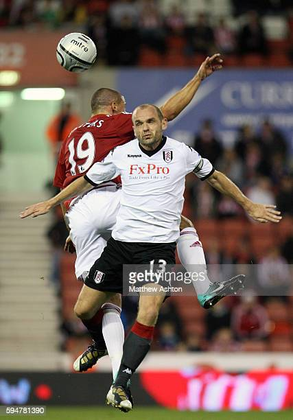 Jonathan Walters of Stoke City and Danny Murphy of Fulham