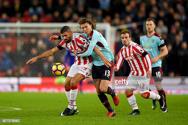 Jonathan Walters of Stoke City and Jeff Hendrick of Burnley compete for the ball during the Premier League match between Stoke City and Burnley at...