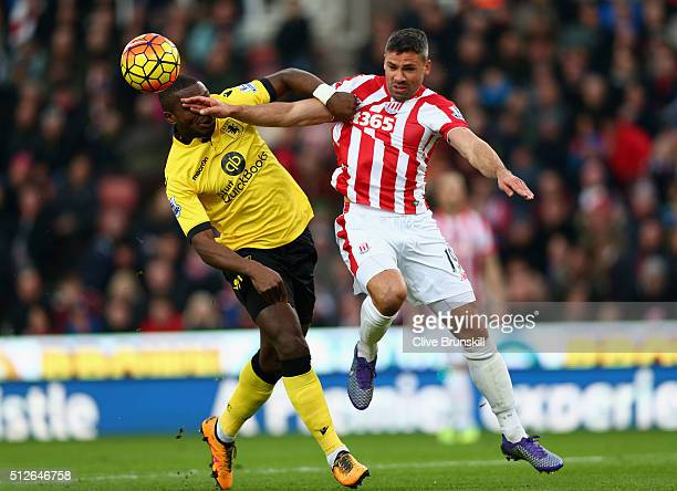 Jonathan Walters of Stoke City and Jores Okore of Aston Villa compete for the ball during the Barclays Premier League match between Stoke City and...