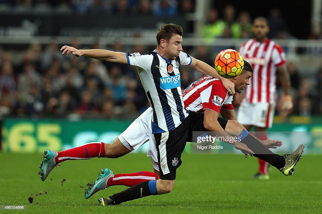 Jonathan Walters of Stoke City and Paul Dummett of Newcastle United compete for the ball during the Barclays Premier League match between Newcastle United and Stoke City at St James' Park on October 31, 2015 in Newcastle upon Tyne, England.