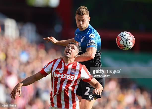 Jonathan Walters of Stoke City and Simon Francis of Bournemouth compete for the ball during the Barclays Premier League match between Stoke City and...