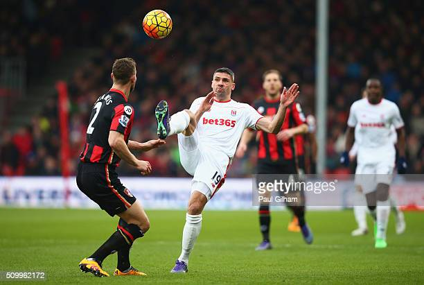 Jonathan Walters of Stoke City and Simon Francis of Bournemouth compete for the ball during the Barclays Premier League match between AFC Bournemouth...