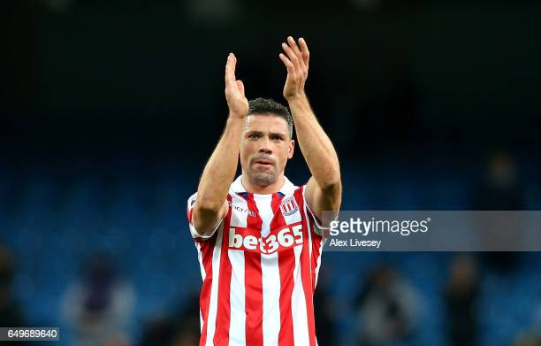 Jonathan Walters of Stoke City applauds supporters during the Premier League match between Manchester City and Stoke City at Etihad Stadium on March...