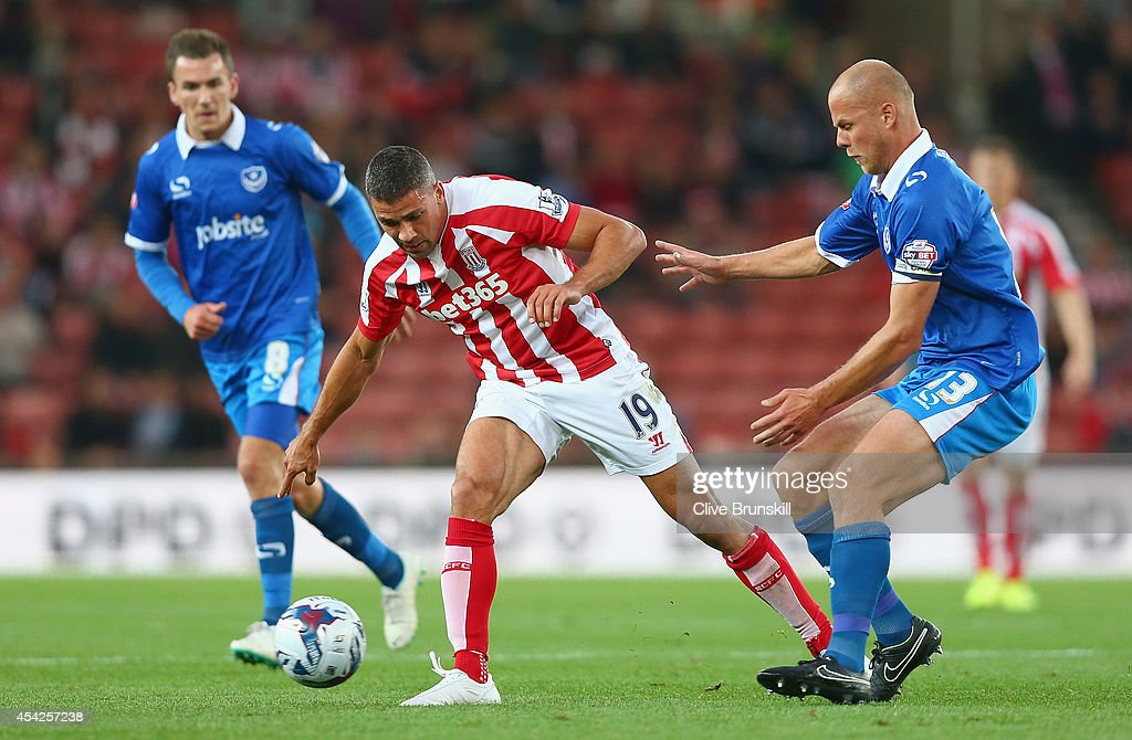 Jonathan Walters of Stoke City attempts to move away from Johnny Ertl d of Portsmouth during the Capital One Cup Second Round match between Stoke City and Portsmouth at Britannia Stadium on August 27, 2014 in Stoke on Trent, England.