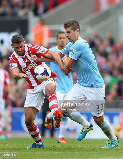 Jonathan Walters of Stoke City battles for the ball with Matija Nastasic of Manchester City during the Barclays Premier League match between Stoke...