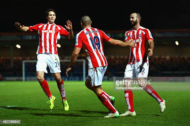 Jonathan Walters of Stoke City celebrates after scoring their fourth goal with team mates Philipp Wollscheid and Marc Wilson of Stoke City during the...