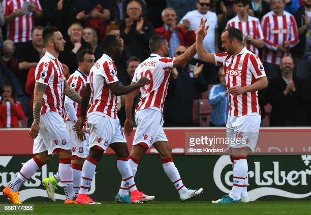Jonathan Walters of Stoke City celebrates scoring his sides first goal with his Stoke City team mates during the Premier League match between Stoke...