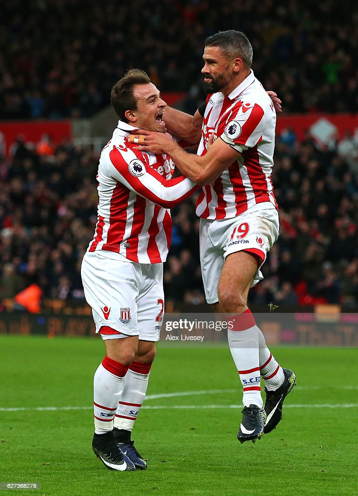 Jonathan Walters (R) of Stoke City celebrates scoring his team's first goal with his team mates Xherdan Shaqiri (L) during the Premier League match between Stoke City and Burnley at Bet365 Stadium on December 3, 2016 in Stoke on Trent, England.