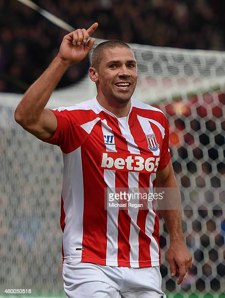 Jonathan Walters of Stoke City celebrates scoring the third goal during the Barclays Premier League match between Stoke City and Arsenal at the...