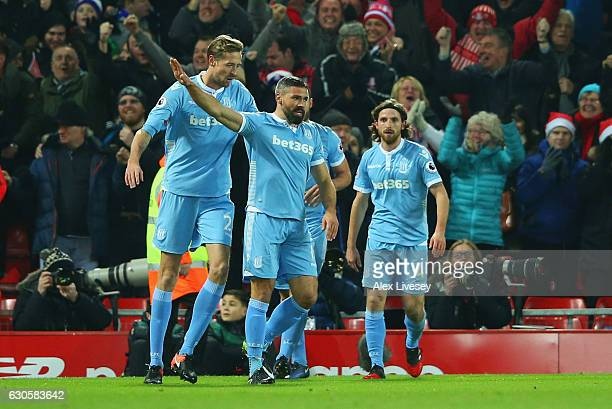 Jonathan Walters of Stoke City celebrates with team mates as he scores their first goal during the Premier League match between Liverpool and Stoke...