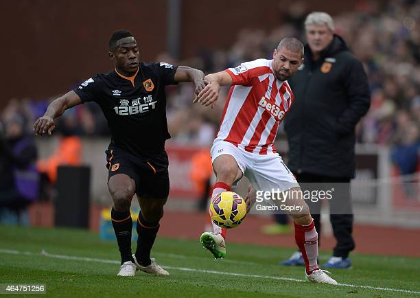 Jonathan Walters of Stoke City competes with Maynor Figueroa of Hull City during the Barclays Premier League match between Stoke City and Hull City...
