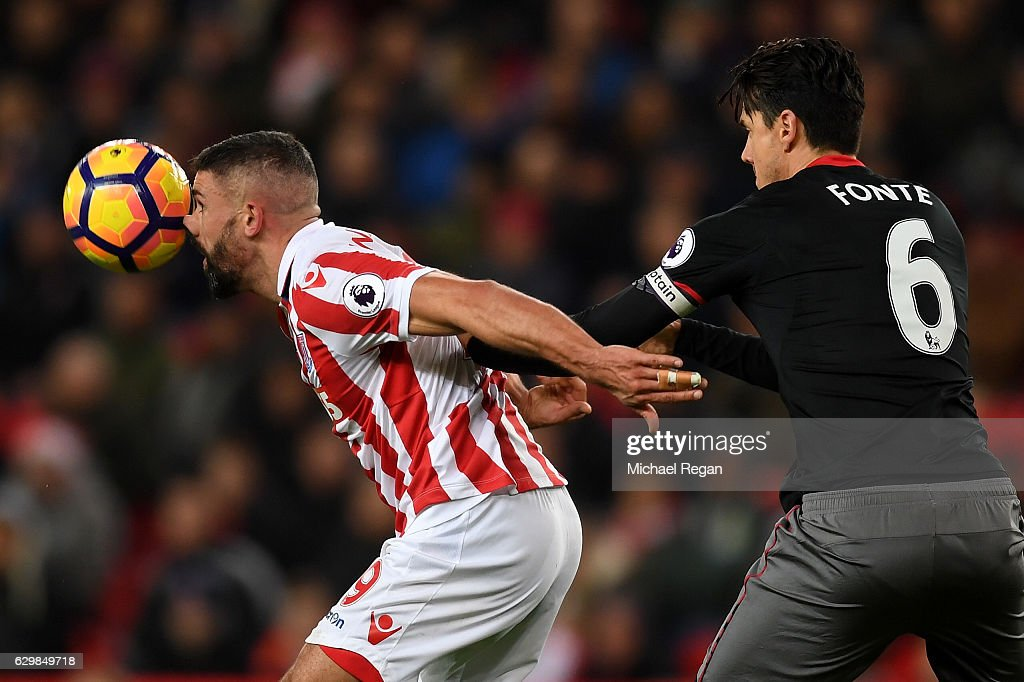 Jonathan Walters of Stoke City controls the ball under pressure of Jose Fonte of Southampton during the Premier League match between Stoke City and Southampton at Bet365 Stadium on December 14, 2016 in Stoke on Trent, England.