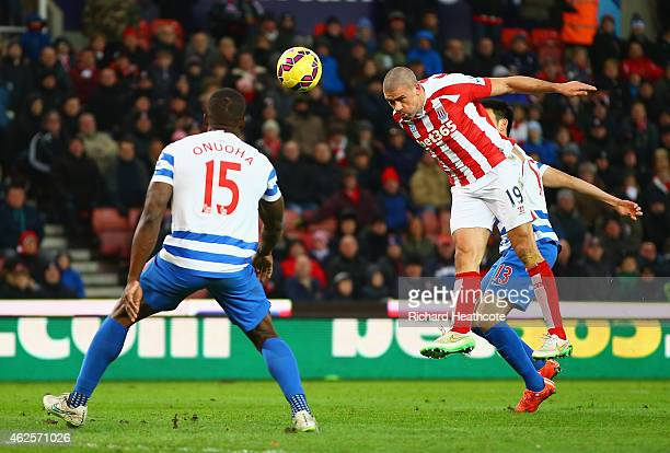 Jonathan Walters of Stoke City heads in their third goal for a hatrick during the Barclays Premier League match between Stoke City and Queens Park...