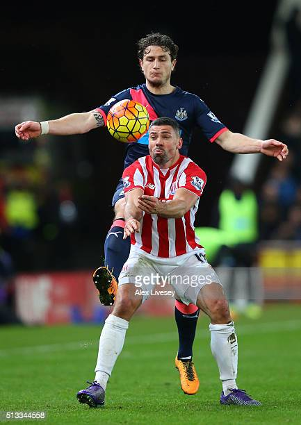 Jonathan Walters of Stoke City holds off Daryl Janmaat of Newcastle United during the Barclays Premier League match between Stoke City and Newcastle...