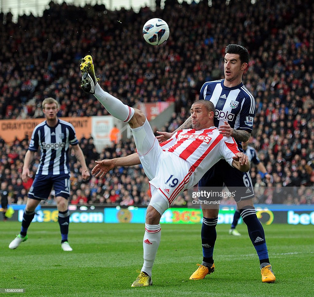 Jonathan Walters of Stoke City in action with Liam Ridgewell of West Bromwich Albion during the Barclays Premier League match between Stoke City and West Bromwich Albion at Britannia Stadium on March 16, 2013 in Stoke on Trent, England.