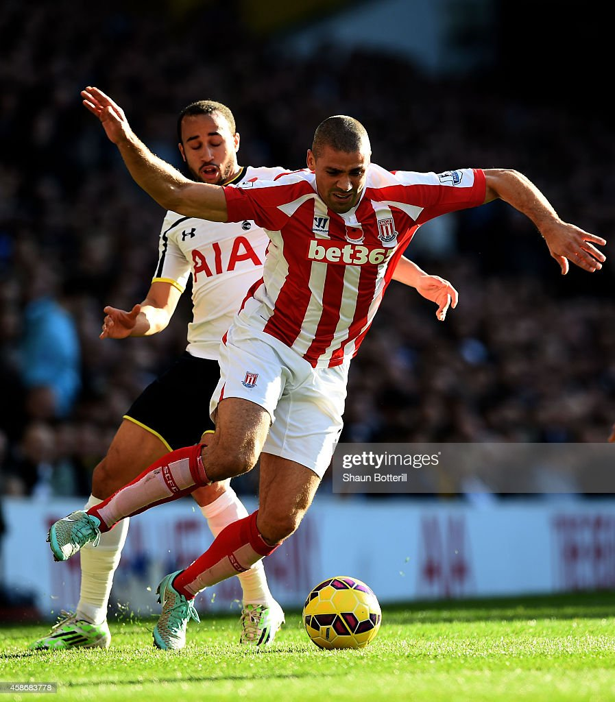Jonathan Walters of Stoke City is challenged by Andros Townsend of Spurs during the Barclays Premier League match between Tottenham Hotspur and Stoke City at White Hart Lane on November 9, 2014 in London, England.