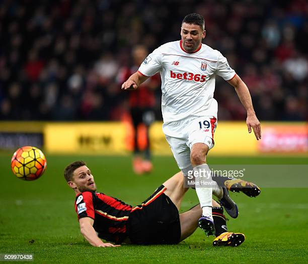 Jonathan Walters of Stoke City is challenged by Simon Francis of Bournemouth during the Barclays Premier League match between AFC Bournemouth and...