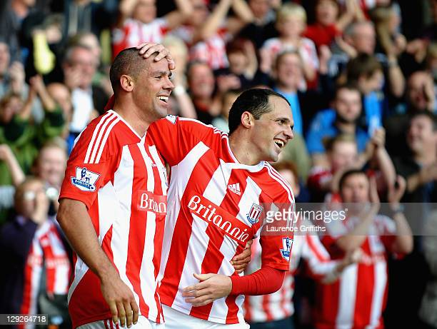 Jonathan Walters of Stoke City is congratulated by Matthew Etherington after scoring the first goal during the Barclays Premier League match between...