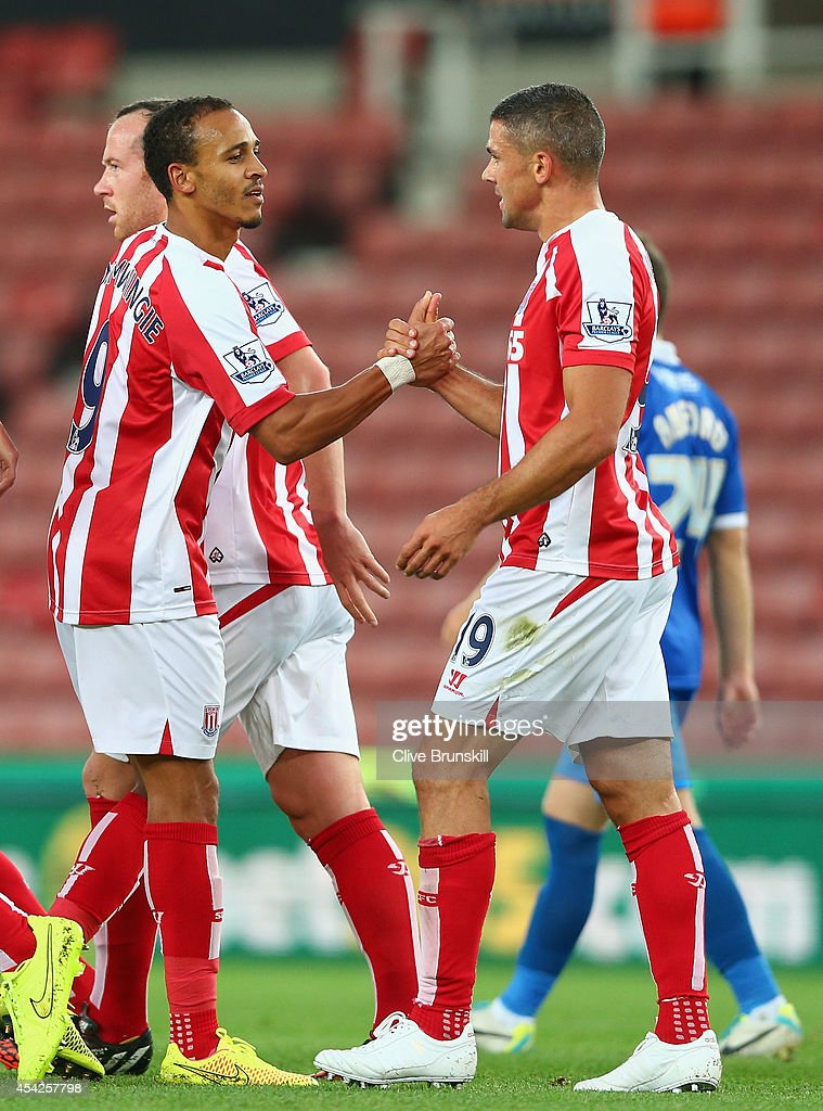 Jonathan Walters of Stoke City is congratulated by team mate Peter Odemwingie after scoring the first goal during the Capital One Cup Second Round match between Stoke City and Portsmouth at Britannia Stadium on August 27, 2014 in Stoke on Trent, England.