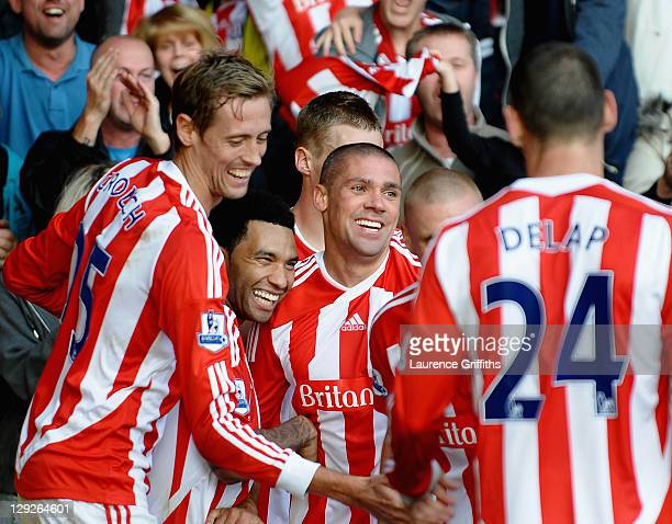 Jonathan Walters of Stoke City is mobbed after scoring the first goal during the Barclays Premier League match between Stoke City and Fulham at...