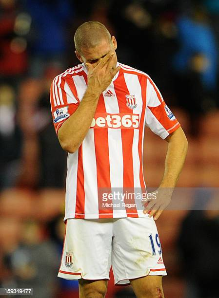 Jonathan Walters of Stoke City reacts after missing a penalty during the Barclays Premier League match between Stoke City and Chelsea at the...