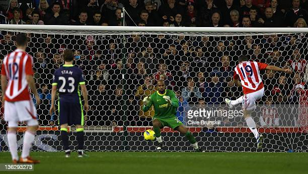 Jonathan Walters of Stoke City scores his teams first goal from the penalty spot during the Barclays Premier League match between Stoke City and...