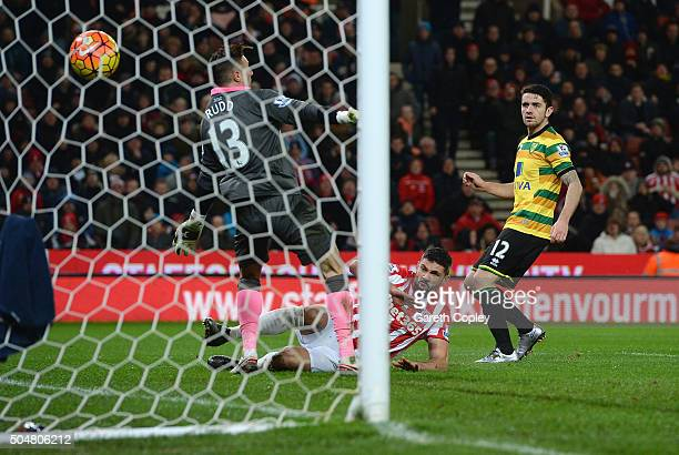 Jonathan Walters of Stoke City scores his team's first goal past Declan Rudd of Norwich City during the Barclays Premier League match between Stoke...