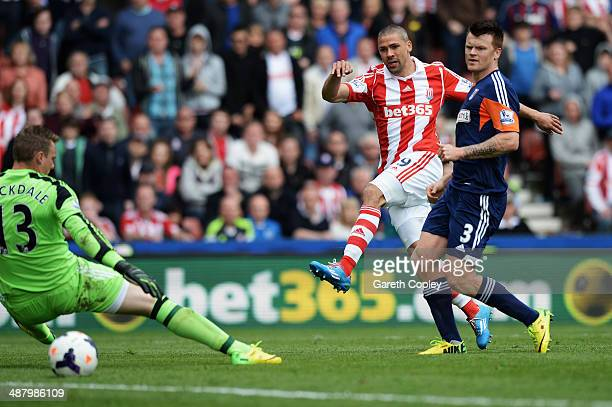 Jonathan Walters of Stoke City shoots and scores his sides fourth goal past David Stockdale the Fulham goalkeeper during the Barclays Premier League...