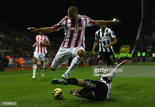 Jonathan Walters of Stoke is tackled by Davide Santon of Newcastle during the Barclays Premier League match between Stoke City and Newcastle United...