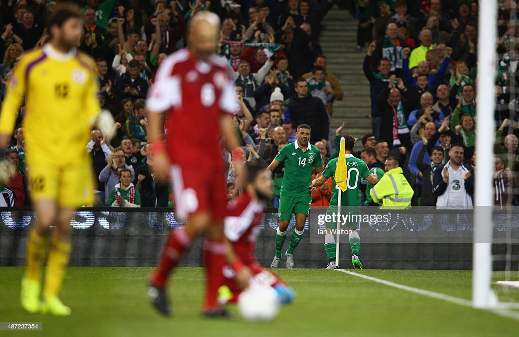 Jonathan Walters of the Republic of Ireland (14) celebrates with Wes Hoolahan (20) as he scores their first goal during the UEFA EURO 2016 Group D qualifying match between Republic of Ireland and Georgia at Aviva Stadium on September 7, 2015 in Dublin, Ireland.