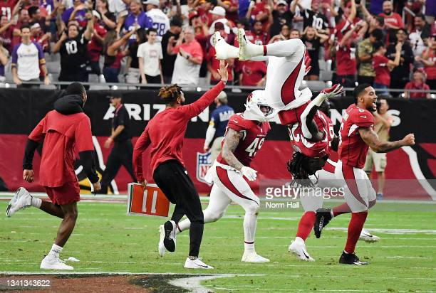 Jonathan Ward of the Arizona Cardinals does a back flip as teammates celebrate on the field after the Minnesota Vikings missed on their game-winning...