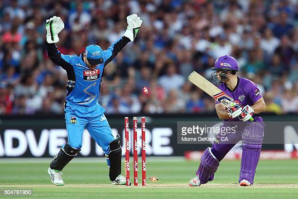 Jonathan Wells of the Hobart Hurricanes is bowled out by Adil Rashid of the Adelaide Strikers during the Big Bash League match between the Adelaide...